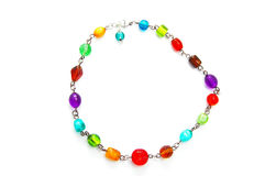 Glass bead necklace. A colorful glass bead necklace on white royalty free stock photos