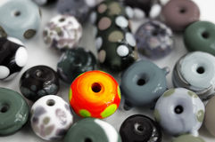 Glass beads. Assortment of glass beads with one bright one Royalty Free Stock Images
