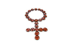 Glass Beads Female Symbol in Red Stock Photo