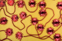 Glass beads with flowers on a golden background Stock Photo