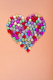 Glass beads heart shape. Large heart shape created with many small colorful heart-shaped glass beads Royalty Free Stock Images