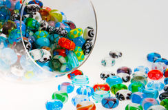 Glass beads in jar. A glass jar full of colorful glass beads Royalty Free Stock Photo