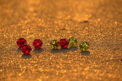 Glass Beads on Sand Stock Images