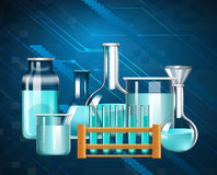 Glass beakers and testtubes with blue liquid Royalty Free Stock Photo