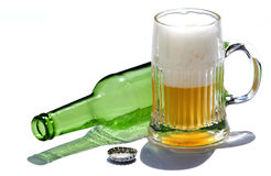 Glass of beer 2. Glass of beer with empty bottle on a white background Royalty Free Stock Photography