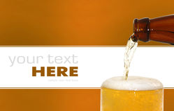 Glass of beer. Closeup with froth Royalty Free Stock Photography