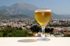 Glass of beer. On a background of mountains stock photos