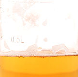 Glass of beer. Close-up with froth Stock Photography