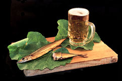 Glass of beer. A glass of fresh beer with smoked fish Stock Photos
