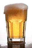 Glass of Beer. Glass of brimming beer. Studio shot on white background stock photos