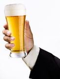 Glass of beer. Is in a hand Royalty Free Stock Images