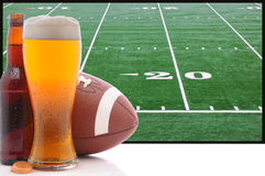Glass of Beer and American Football Royalty Free Stock Photos