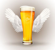 Glass of beer with angel wings Royalty Free Stock Image