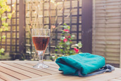 Glass of beer and apron on table Royalty Free Stock Photos