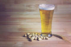 Glass beer, bale and pistachios Stock Image