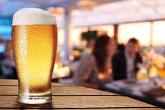 A glass of beer on the bar counter. Stock Photo