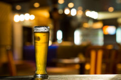 Glass of Beer on Bar Counter Royalty Free Stock Photography