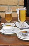 Glass of beer on bar table with napkins Stock Photography