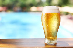 Glass of beer on the bar table at the open-air cafe. Stock Images