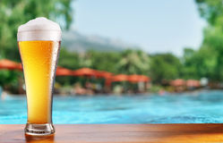 Glass of beer on the bar table at the open-air cafe. Royalty Free Stock Image