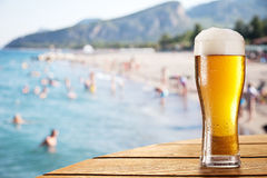 Glass of beer on the bar table at the open-air cafe. Stock Image