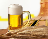 Glass of beer with barley i Royalty Free Stock Photography