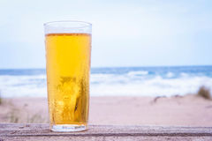 Glass of beer. On the beach Royalty Free Stock Images