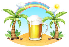 A glass of beer at the beach Royalty Free Stock Photo