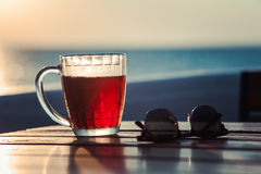 Glass of beer on the beach. Summer Stock Photo