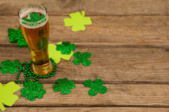 Glass of beer, beads and shamrock for St Patricks Day Royalty Free Stock Image