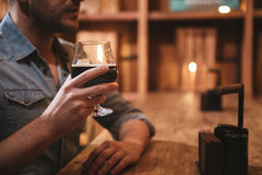 Glass with beer being held by a handsome nice man Stock Photography