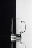 Glass of beer on the black and white background Stock Image