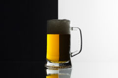Glass of beer on the black and white background Stock Photos
