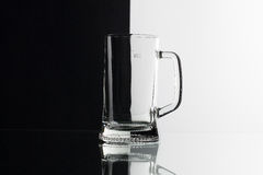 Glass of beer on the black and white background Royalty Free Stock Images