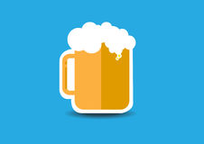 A glass of beer. With blue background Royalty Free Stock Photo