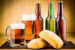 Glass of beer with bottles Royalty Free Stock Images