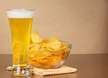 Glass of beer, bowl with chips Royalty Free Stock Photos