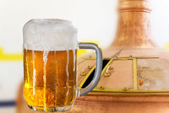 Glass of beer in the brewery Royalty Free Stock Photography