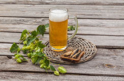 Glass of beer and brown bread with sprats on a wooden table Royalty Free Stock Photography