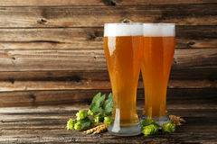 Glass of beer on a brown wooden background. Stock Photo