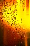 Glass of beer with bubbles Stock Photography