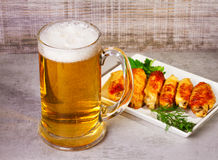 Glass of beer and buffalo chicken wings Royalty Free Stock Photo