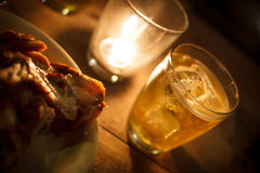 Glass of beer with candle light in the night. Scene royalty free stock image