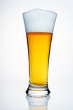 A glass of beer with a cap of foam. On white background Stock Photo