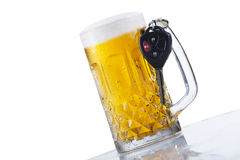 A glass of beer and car keys. Concept of Drinking and Driving, beer and car keys Stock Photo