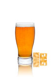 Glass of beer and cheese isolated on a white background. Glass of beer with cheese isolated on a white background Stock Photos