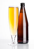 Glass of beer cider with bottle on white Royalty Free Stock Photos