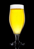 Glass of beer cider with foam golden color  black Royalty Free Stock Photo