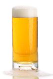 Glass of beer close-up with froth Royalty Free Stock Photos