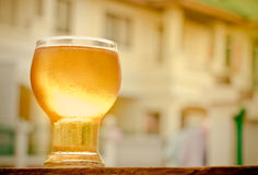Glass of beer. Close up glass of beer on wooden table relaxing in the evening home Stock Photography